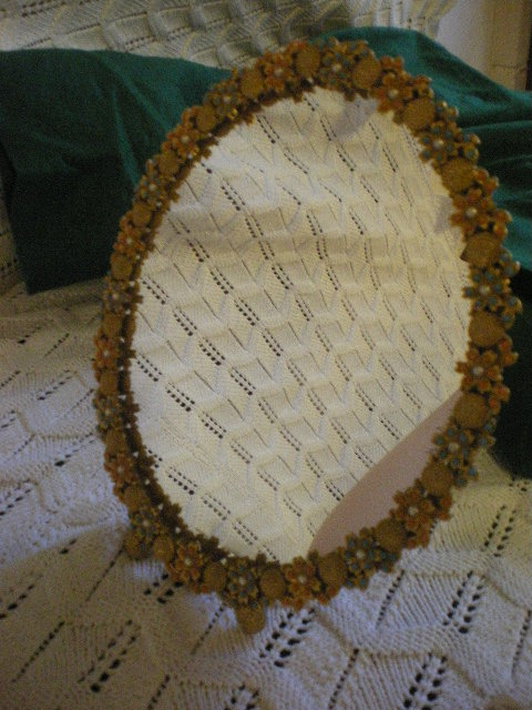 1950's small oval beaded mirror by Kigu
