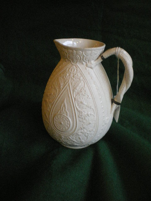 19thc White Embossed Jug With Twist Handle