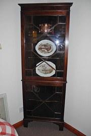 A nice mahogany corner cabinet