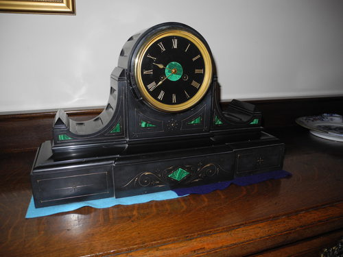 Black slate mantel clock with malachite