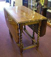 Golden oak gateleg table from c.1890