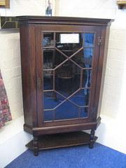 Oak corner cabinet on stand