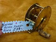 Vintage brass fishing reel