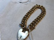 15ct gold link bracelet with 9ct gold heart