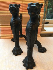 Pair cast iron fire dogs with lioness heads