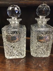 Pair crystal decanters with silver liquor labels