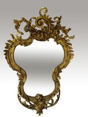 A 19th century giltwood and gesso mirror, the glass