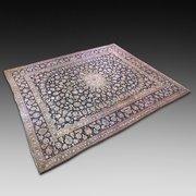 A Large Persian Kashan Carpet