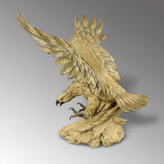 A large cast sculpture of an eagle