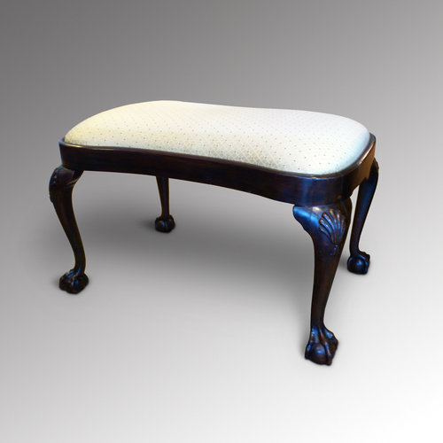 A mahogany kidney shaped stool