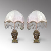 A pair of 19th century brass lamps