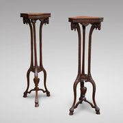 A pair of Late 19thC Carved Mahogany Torcheres in