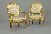 A pair of late Victorian giltwood armchairs