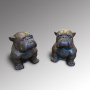 Pair of Carved Magma Bull Dogs