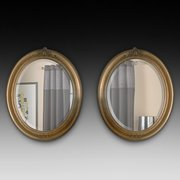 Pair of Edwardian Giltwood Oval Mirrors