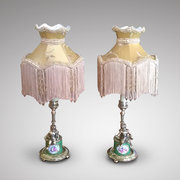 Pair of ormolu and porcelain table lamps