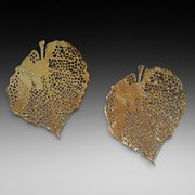 Pair of pierced brass wall decorations