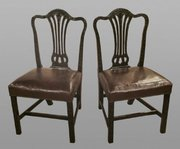 A pair of leather seated Georgian side chairs.