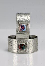 Pair of Arts & Crafts Pewter & Enamel Napkin Rings