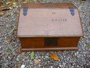 Dated oak slant front box 1740
