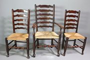 Set of 12 Lancashire Wavy Ladderback Chairs.