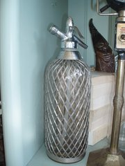 1930's metal mesh covered soda syphon