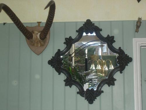 Black Rococo style mirror