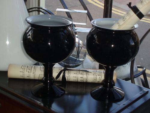 Black glass vases with white inner