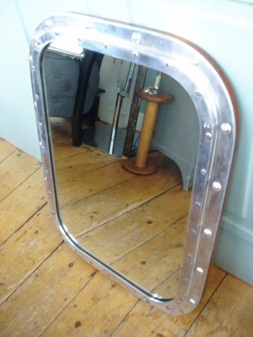 Boat window mirror polished metal