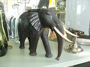 Ebony wood elephant with ivory tusks