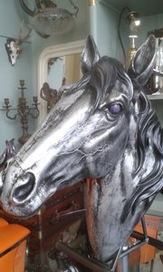 Silvered horse head with purple eyes