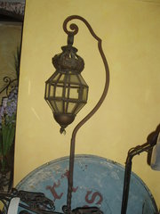 Wrought iron stands with lanterns