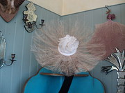feather and jeweled flower hat