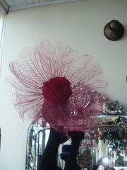 fushia feather fan with silk flower